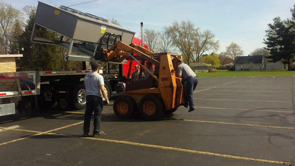 Moving New Air Conditioning Rooftop Unit At Merrill
